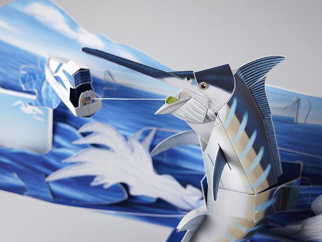 Papercraft imprimible y recortable de una escena desplegable de pesca de un pez espada. Manualidades a Raudales.
